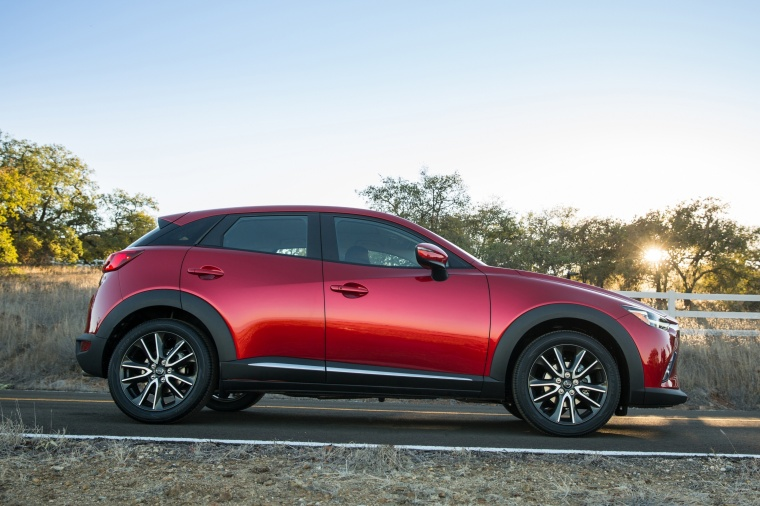 2017 Mazda CX-3 in Soul Red Metallic from a side view