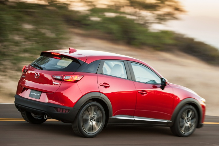 Driving 2017 Mazda CX-3 in Soul Red Metallic from a rear right three-quarter view