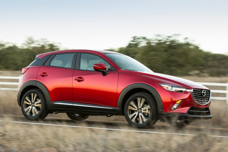 Driving 2017 Mazda CX-3 in Soul Red Metallic from a front right three-quarter view