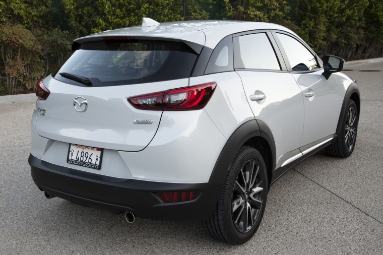 2017 Mazda CX-3 AWD in Crystal White Pearl Mica from a rear right view