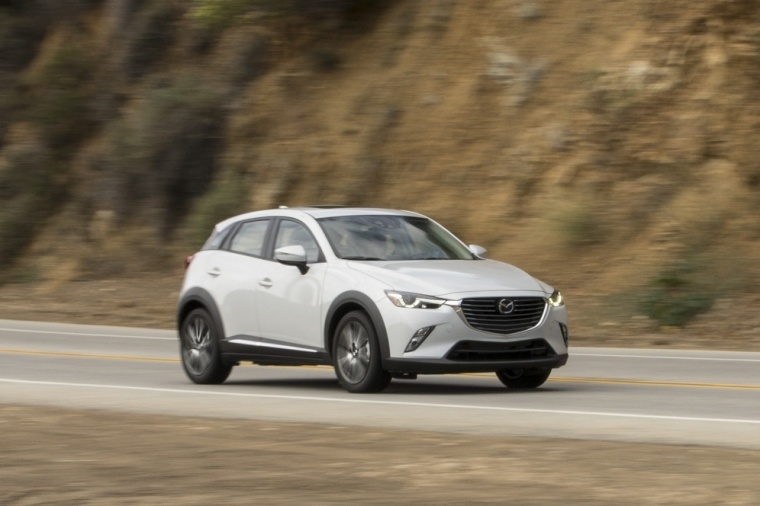 Driving 2017 Mazda CX-3 AWD in Crystal White Pearl Mica from a front right three-quarter view