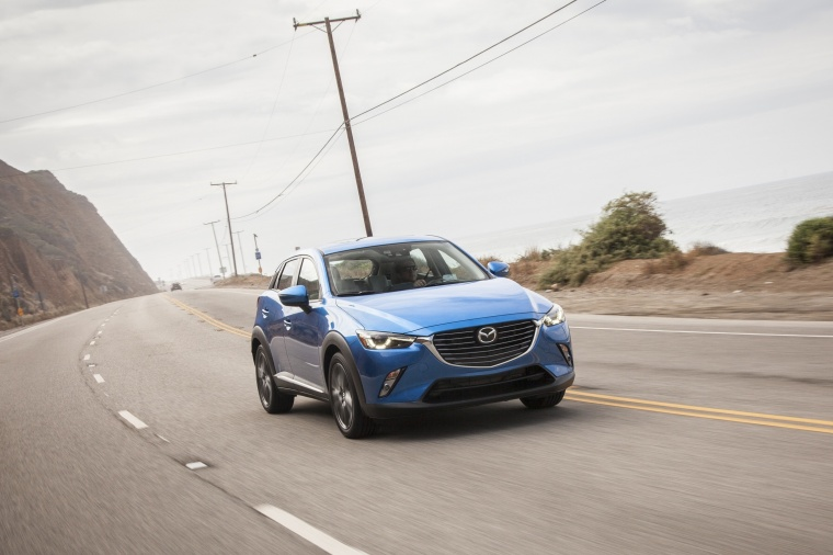 Driving 2017 Mazda CX-3 in Dynamic Blue Mica from a front right three-quarter view
