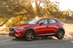 Picture of a 2018 Mazda CX-3 in Soul Red Metallic from a side perspective