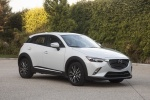 Picture of a 2018 Mazda CX-3 AWD in Snowflake White Pearl Mica from a front right three-quarter perspective