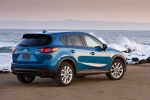 Picture of a 2014 Mazda CX-5 in Sky Blue Mica from a rear right three-quarter perspective
