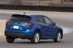 Picture of a driving 2014 Mazda CX-5 in Sky Blue Mica from a rear right three-quarter perspective