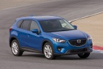 Picture of a driving 2014 Mazda CX-5 in Sky Blue Mica from a front right three-quarter perspective