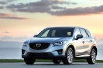 Picture of a 2014 Mazda CX-5 in Liquid Silver Metallic from a front left three-quarter perspective