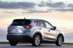 Picture of a 2014 Mazda CX-5 in Liquid Silver Metallic from a rear right three-quarter perspective