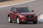 Picture of a driving 2014 Mazda CX-5 from a front right perspective