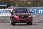 Picture of a driving 2014 Mazda CX-5 from a frontal perspective