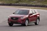 Picture of a driving 2014 Mazda CX-5 from a front left perspective