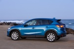 Picture of a 2014 Mazda CX-5 in Sky Blue Mica from a rear left three-quarter perspective