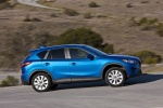 Picture of a 2014 Mazda CX-5 in Sky Blue Mica from a right side perspective
