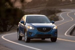 Picture of a driving 2014 Mazda CX-5 in Sky Blue Mica from a front right perspective