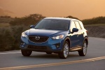 Picture of a driving 2014 Mazda CX-5 in Sky Blue Mica from a front left perspective