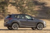 Driving 2016 Mazda CX-5 in Meteor Gray Mica from a rear right three-quarter view