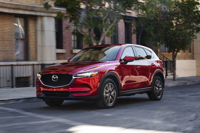 Driving 2017 Mazda CX-5 Grand Touring AWD in Soul Red Crystal Metallic from a front left view