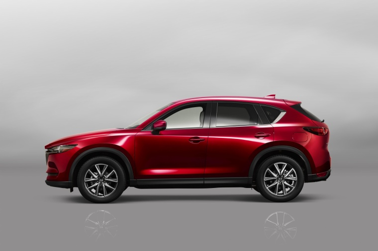 Picture of a 2017 Mazda CX-5 Grand Touring AWD in Soul Red Crystal Metallic from a side perspective