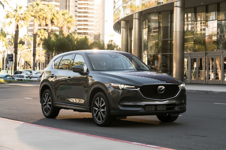 Driving 2017 Mazda CX-5 in Machine Gray Metallic from a front right three-quarter view