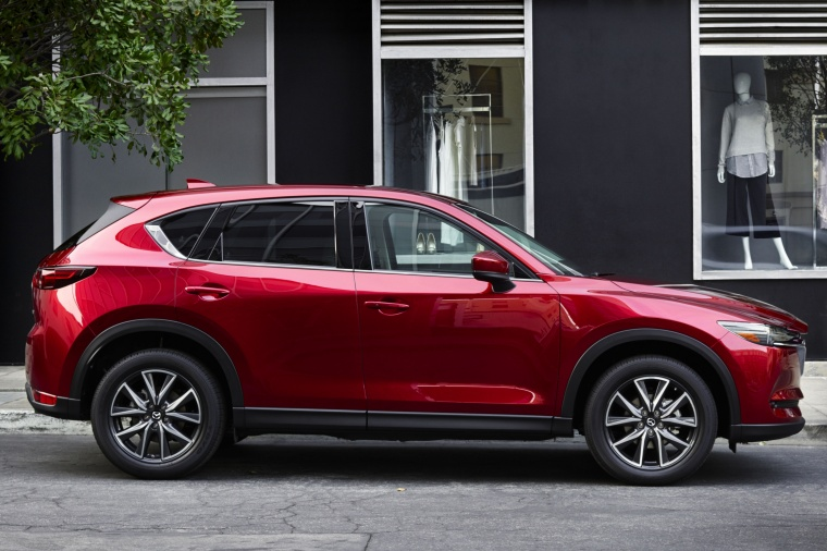 Picture of a 2017 Mazda CX-5 Grand Touring AWD in Soul Red Crystal Metallic from a right side perspective