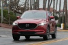 Picture of a driving 2017 Mazda CX-5 Grand Touring AWD in Soul Red Crystal Metallic from a frontal perspective