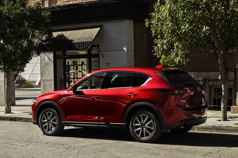 2018 Mazda CX-5 Grand Touring AWD in Soul Red Crystal Metallic from a rear left three-quarter view