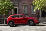 Picture of a driving 2018 Mazda CX-5 Grand Touring AWD in Soul Red Crystal Metallic from a right side perspective