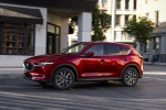 Picture of a driving 2018 Mazda CX-5 Grand Touring AWD in Soul Red Crystal Metallic from a front left three-quarter perspective