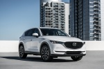 Picture of a 2018 Mazda CX-5 AWD in Snowflake White Pearl Mica from a front right perspective