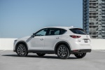 Picture of a 2018 Mazda CX-5 AWD in Snowflake White Pearl Mica from a rear left three-quarter perspective