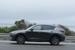 Picture of a driving 2018 Mazda CX-5 in Machine Gray Metallic from a side perspective