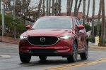 Picture of a driving 2019 Mazda CX-5 Grand Touring AWD in Soul Red Crystal Metallic from a frontal perspective