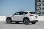 Picture of a 2019 Mazda CX-5 AWD in Snowflake White Pearl Mica from a rear left three-quarter perspective