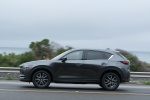 Picture of a driving 2019 Mazda CX-5 in Machine Gray Metallic from a side perspective