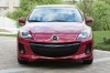 2013 Mazda 3i Sedan in Velocity Red Mica from a frontal view