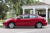2013 Mazda 3i Sedan in Velocity Red Mica from a side view
