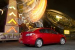 2013 Mazda 3i Sedan in Velocity Red Mica - Static Rear Right Three-quarter View