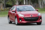 2013 Mazda 3i Sedan in Velocity Red Mica - Driving Front Right View