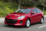 2013 Mazda 3i Sedan in Velocity Red Mica - Driving Front Left View