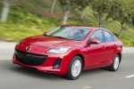 2013 Mazda 3i Sedan in Velocity Red Mica - Driving Front Left Three-quarter View