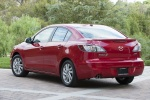 2013 Mazda 3i Sedan in Velocity Red Mica - Static Rear Left Three-quarter View