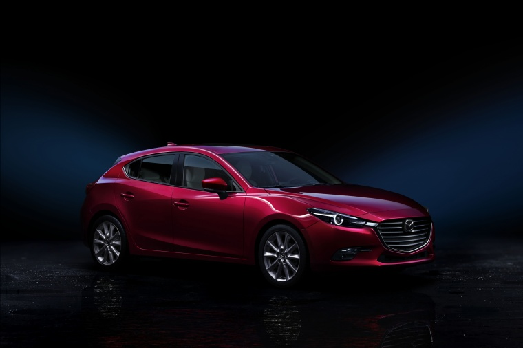 2017 Mazda Mazda3 Grand Touring 5-Door Hatchback in Soul Red Metallic from a front right three-quarter view