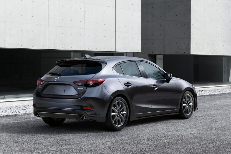 2018 Mazda Mazda3 Grand Touring 5-Door Hatchback in Machine Gray Metallic from a rear right three-quarter view