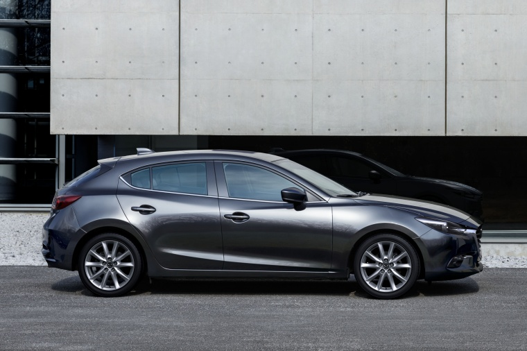 2018 Mazda Mazda3 Grand Touring 5-Door Hatchback in Machine Gray Metallic from a side view