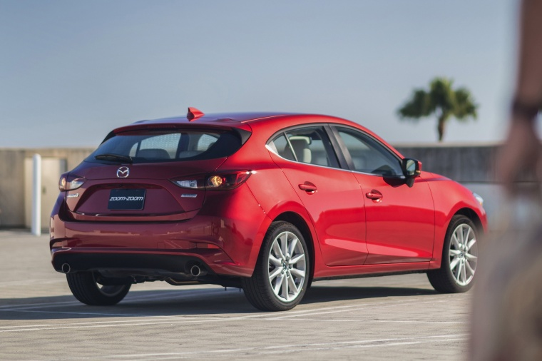 2018 Mazda Mazda3 Grand Touring 5-Door Hatchback in Soul Red Metallic from a rear right view