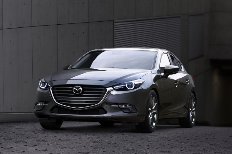 2018 Mazda Mazda3 Grand Touring 5-Door Hatchback in Machine Gray Metallic from a front left view