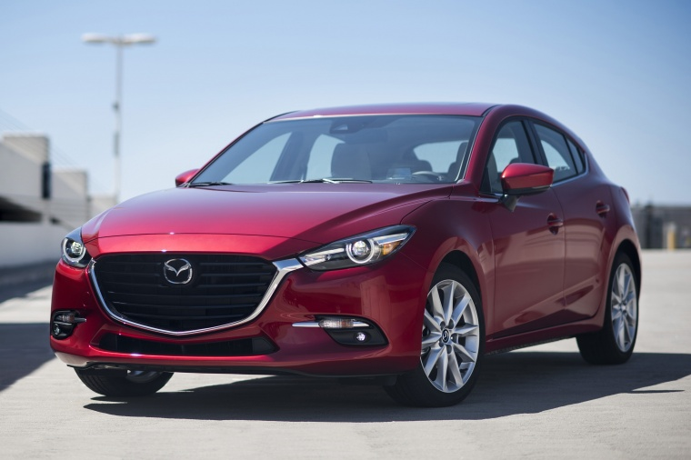 2018 Mazda Mazda3 Grand Touring 5-Door Hatchback in Soul Red Metallic from a front left view