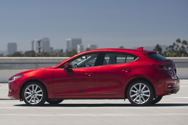 2018 Mazda Mazda3 Grand Touring 5-Door Hatchback in Soul Red Metallic from a side view