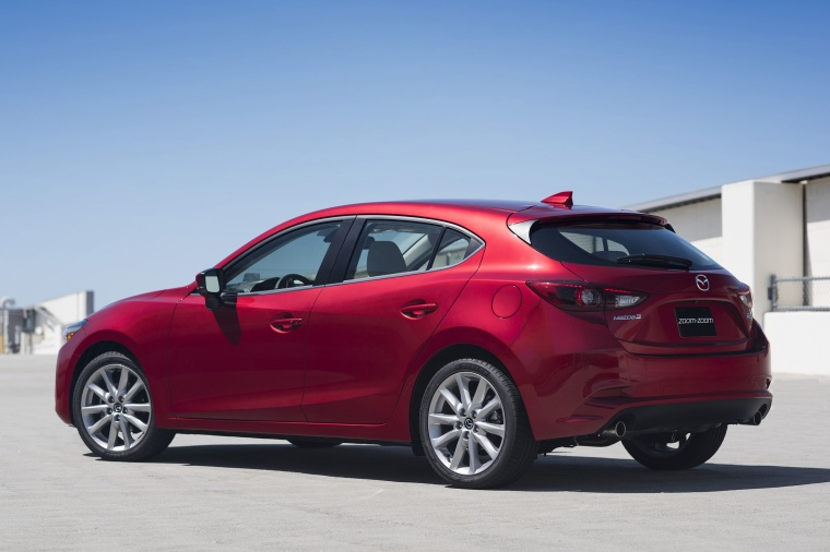 2018 Mazda Mazda3 Grand Touring 5-Door Hatchback in Soul Red Metallic from a rear left three-quarter view